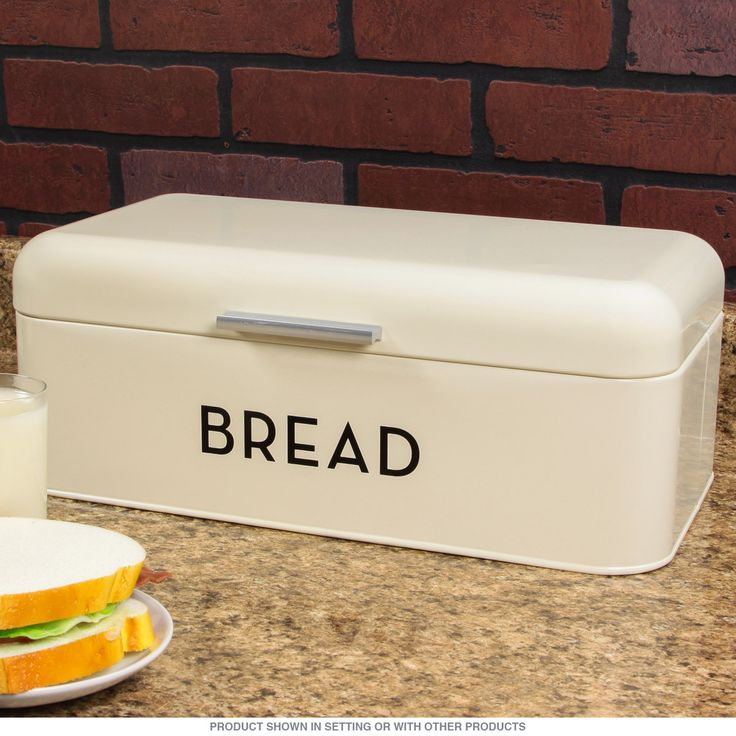 This Bake Shop metal bin is a handsome vintage style storage box for your kitchen that evokes old time bakeries with beautifully lacquered color and design. It includes a matching lid and can store bread, pastry or any other fresh baked goods you can cook up. Measures 16