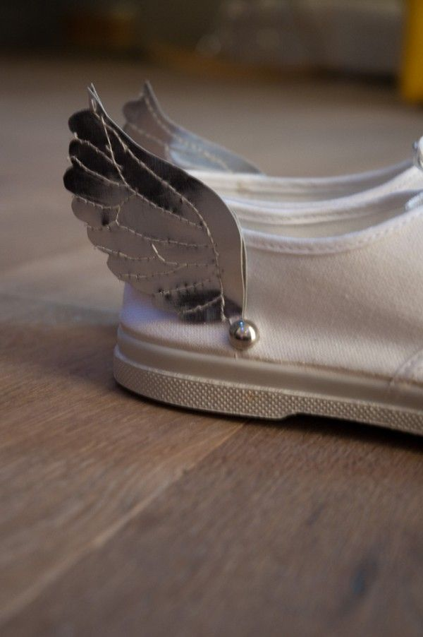 Whimsical winged tennis shoes