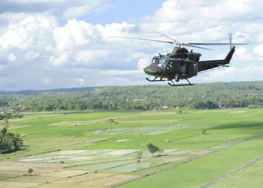 Canadian Forces Bell CH-146 Griffon helicopters operate in the Philippines during Operation RENAISSANCE, Canada's contribution to the disaster relief mission in that country.Photos by Corporal Darcy Lefebvre, Canadian Forces Combat Camera.