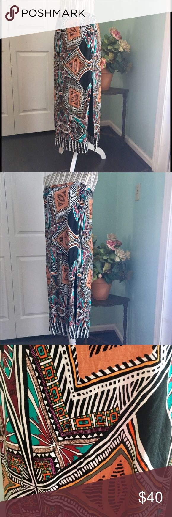 NWT ANTHROPOLOGIE Maeve Tribal Maxi Skirt This Anthropologie skirt can easily be used as a strapless dress as shown. Tribal print.   Size S, measures approximately 36 inches long and has an elastic waist that measures 13.5 inches unstretched.   Side front slit. Fully lined.   NWT. Never worn. Bought at Anthropologie. Anthropologie Skirts Maxi