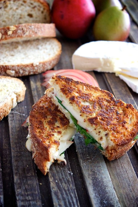 Ham, Brie, Spinach & Pear Panini  •2 slices whole wheat bread   •olive oil butter spread (or softened butter)   •Dijon mustard  •sliced brie   •1/4 pear, sliced   •sliced ham (or Canadian bacon)  •baby spinach
