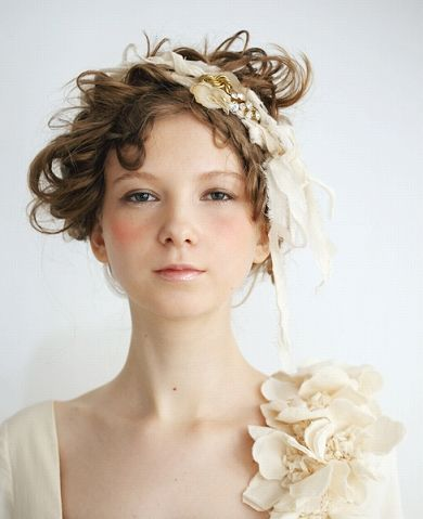 Shiny lips, young, graphic blush. Love the Victorian, messy hair.