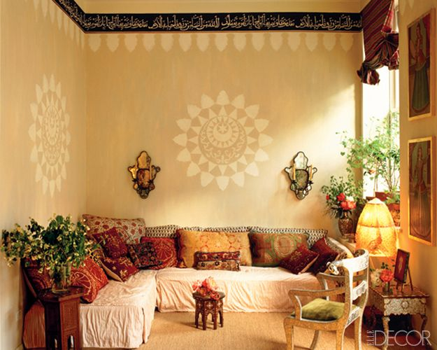 At her fanciful Manhattan lair, globe-trotting  photographer Calliope conjured an exotic corner with stenciled walls and a low slipcovered banquette layered with hand-blocked bolsters and antique embroidered pillows. (August/September 1993)   - ELLEDecor.com