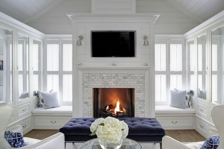 Fireplace surround by gray bricks, navy bench in bedroom sitting area   Dixon Kirby Homes