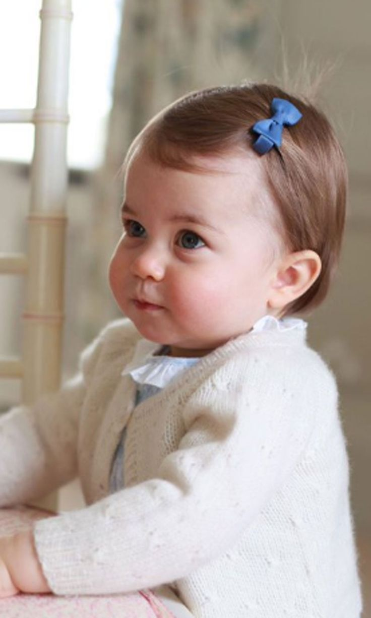 It's Princess Charlotte's 1st birthday! These photos show just how quickly she's growing up.