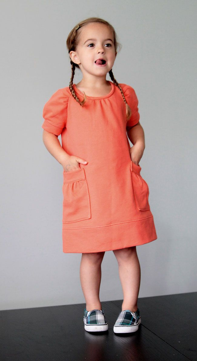 you can sew this adorable sweatshirt dress for a little girl with just a raglan t-shirt pattern. learn how to modify the pattern and sew the dress with this easy tutorial.