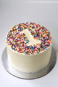 i heart baking!: rainbow sprinkle first birthday smash cake - vanilla cake filled with fresh strawberries and whipped cream