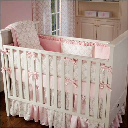 This is the pink and taupe damask crib bedding we got for our baby girl's nursery <3