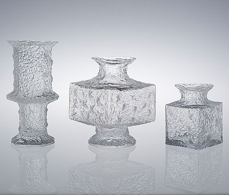"""""""TIMO SARPANEVA, VASER, 3 st, glas, """"Nardus"""", """"Crassus"""", """"Krookus"""" Iittala, 1960-70-tal. En signerad. Reliefmönster. Höjd 15-25 cm. Den lägsta signerad TS."""" (quote) via bukowskis.com Finnish designer Timo Sarpaneva 3 glass vases"""