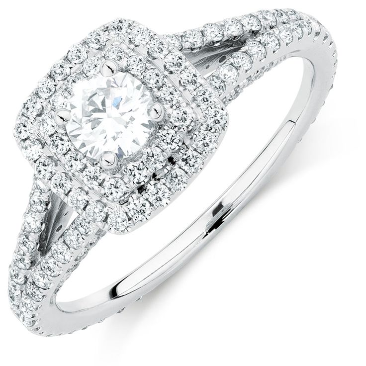 Capture her beauty in diamonds with this gorgeous Arpeggio ring, featuring a total 0.95 carat of diamonds. Showcasing a round brilliant diamond enhanced by a double halo, and complemented by split shank shoulders, this 14kt white gold ring embodies all that is love. The finishing touch is the 14kt rose gold detail, holding a signature pink sapphire below the main setting. Exclusive to the Michael Hill Designer Bridal Collection.