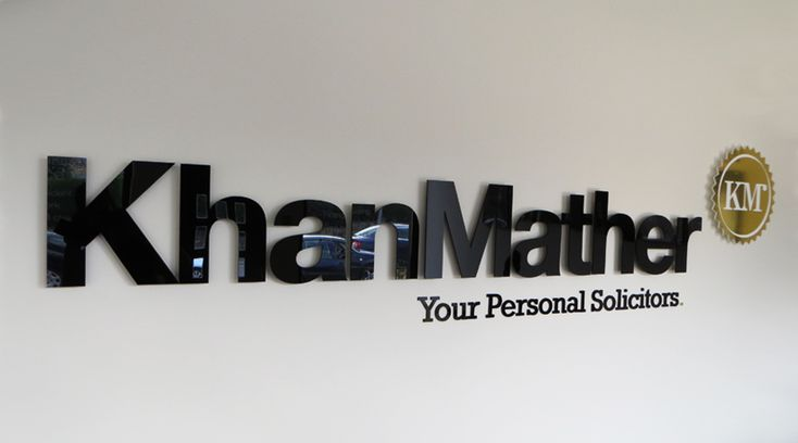 Black and Gold acrylic logo/letering applied to office wall by Space3.co.uk