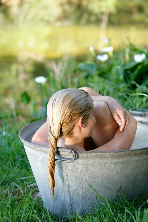 Old Time Way Of Taking A Bath.  Took a bath like this until age 7. In the summer, took your bath on the back porch and in the winter you bathed in the kitchen. We would have to get our water from the well and Mom would heat up some in a big pot on the stove to mix with the cold well water. Our doors then were curtains. I loved those days - although I do love my bathroom and everything in it, especially the tub and the toilet :)