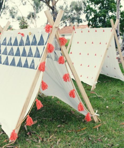 Tepees out of old sheets...kids could sponge paint designs first