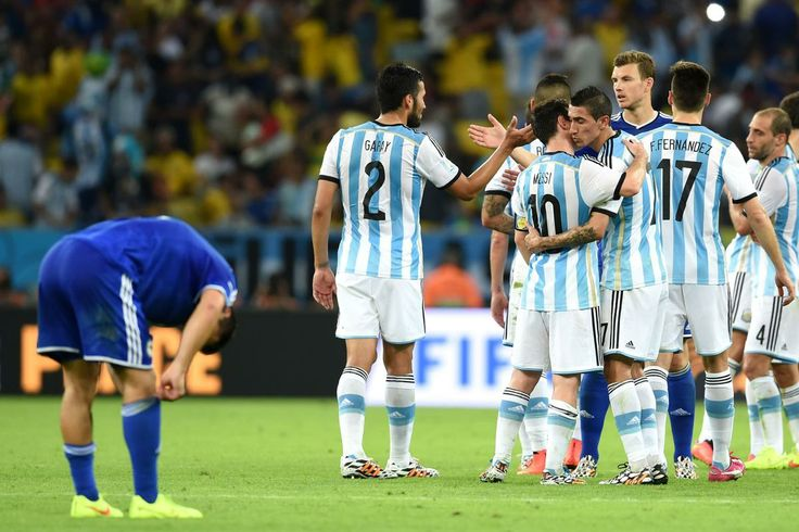 Lionel Messi and Angel di Maria of Argentina celebrate after defeating Bosnia and Herzegovina 2-1 Argentina players celebrate the 2-1 victor...