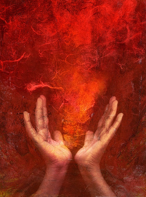 "Photo based mixed medium images of hands with red ""fire"""