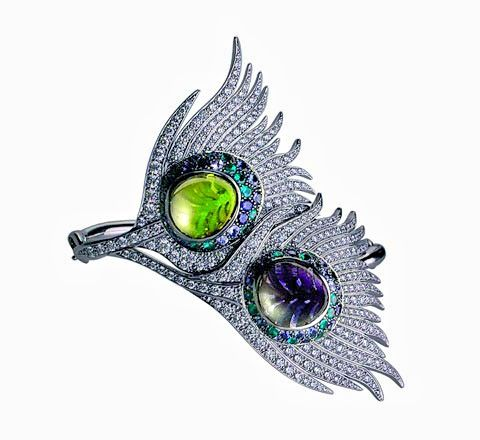 Lydia Courteille Carrera y Carrera peacock inspired cuff. The bracelet is done in white gold with diamonds, green tsavorite, iolite, blue sapphires, and green tourmaline.