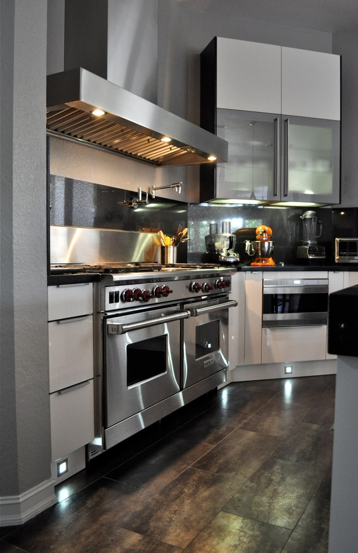 """The 60"""" Wolfe commercial stove with two ovens, pot filler and large stainless hood make this Boca Raton's chef glad to come to work each day. Greeson and Fast Design"""