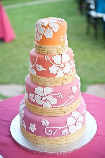 Love it! Fushia transition to an orange fondant base with white hibiscus and plumerias with four rows as bamboo at the bottom of each tier to capture a vintage Hawaii feel. Cake: Paradise Pasteries, Gendale, CA; Photography: Rachel Robertson Photography, Honolulu, HI Design Inspired by: cakelava