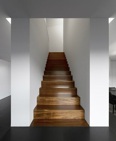 Staircase inside the House in Lisbon by Portugese architects Gabriela Goncalves and Leonel Lopes. Photo by Fernando Guerra.