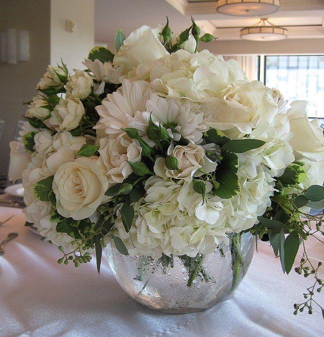 Bubble bowl centerpiece of white hydrangea ivory roses