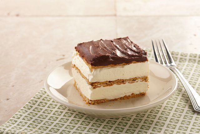 """Our Graham Cracker Eclair """"Cake"""" is a spectacular no-bake dessert recipe - no oven required and no baking skills required!  Just mix, layer and chill - then serve up a delectable dessert for a crowd!"""