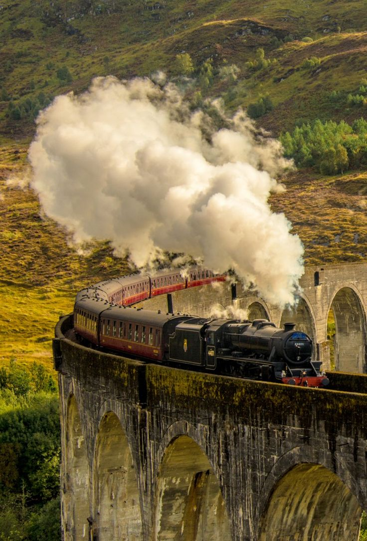 The Jacobite Steam Train on the Glenfinnan Viaduct.   I love riding the rails this journey I have done many many times. I  grew up in this area.  Take me back to Bonnie Scotland and the Jacobite steam train from Fort William to Mallaig.