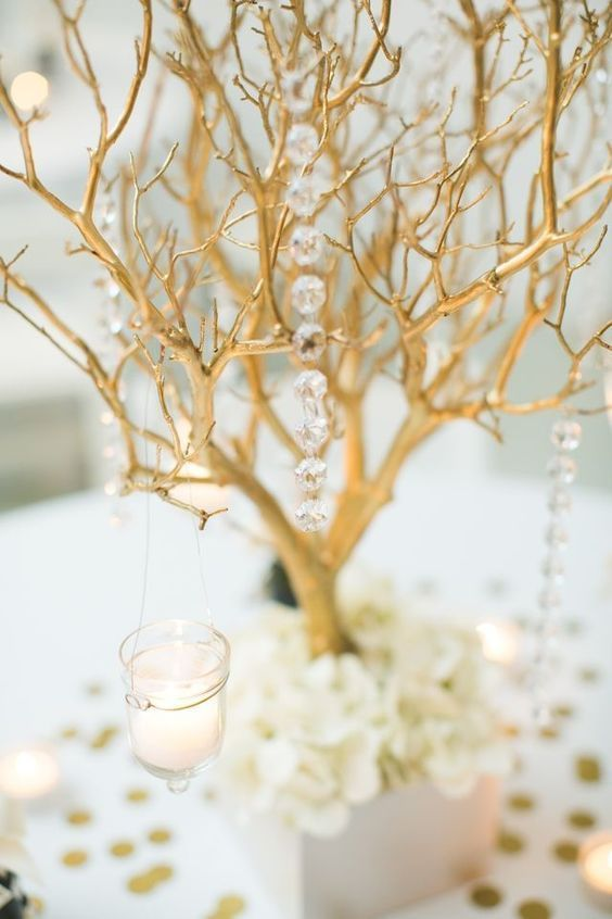 Metallic Branch with Crystals - For Modern Brides: 25 Fabulous Wedding Centerpieces Without Flowers - EverAfterGuide