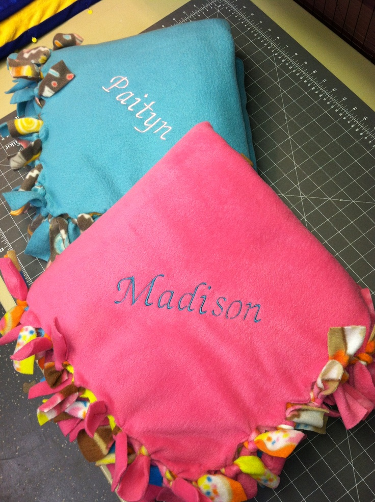 Embroidered names onto homemade blankets to personalize a Christmas gift for a friend