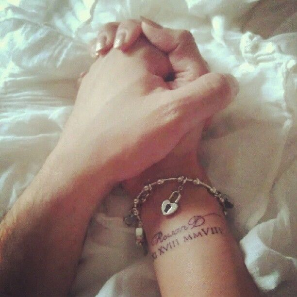 Love this idea and story! mothers day is on its way again?....My wrist tattoo honoring my son on Mothers Day 2012. Its his name Rowan D and birthdate in roman numerals - 11 18 2008 .   So far my fav idea for Gabriel.. But on the neck