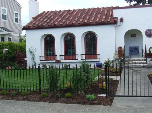 Simple Landscaping Around Wrought Iron Fencing