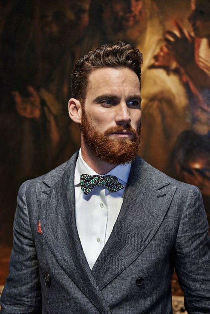 tipos-de-barba-hombre-con-barba-roja-elegante-con-traje-gris-ojos-azules