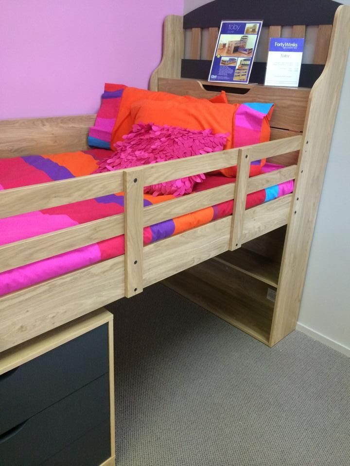 There is a storage area behind where the pillow goes. You can also change which side you want the rails. Easy to ensemble I am told. Prob would leave underneath the bed as a play area. Personally I like two set of drawers underneath the bed
