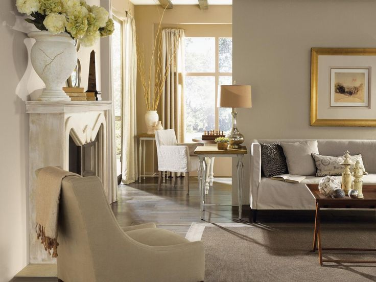 A Neutral Palette Tones Down The More Traditional Furnishings In This Luxurious Transitional Living Room