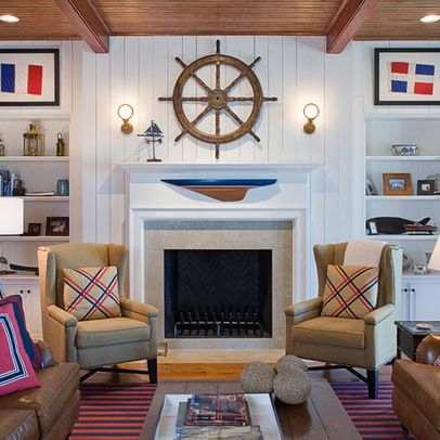 Classic nautical look for this living room from the board and batten to the helm over the mantel.
