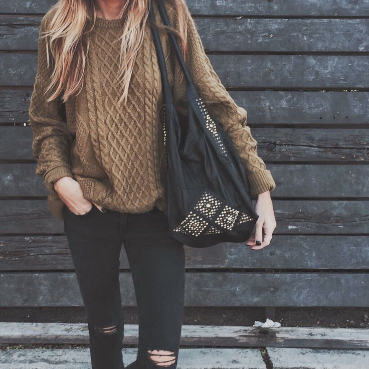 brown oversized sweater , ripped black skinny jeans , black boho bag w/ gold detailing
