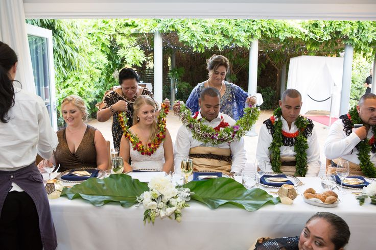 The Bride and Groom are presented with floral leis with the national flower of Tonga // Flowers: Toni Saddington // PC: Liv Style photography