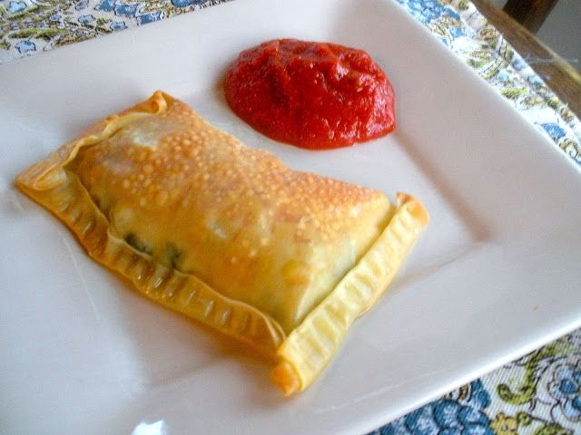Egg Roll Wrapper Calzones.  An Egg Roll Wrapper has only 80 calories!  A great light way to enjoy pizza!