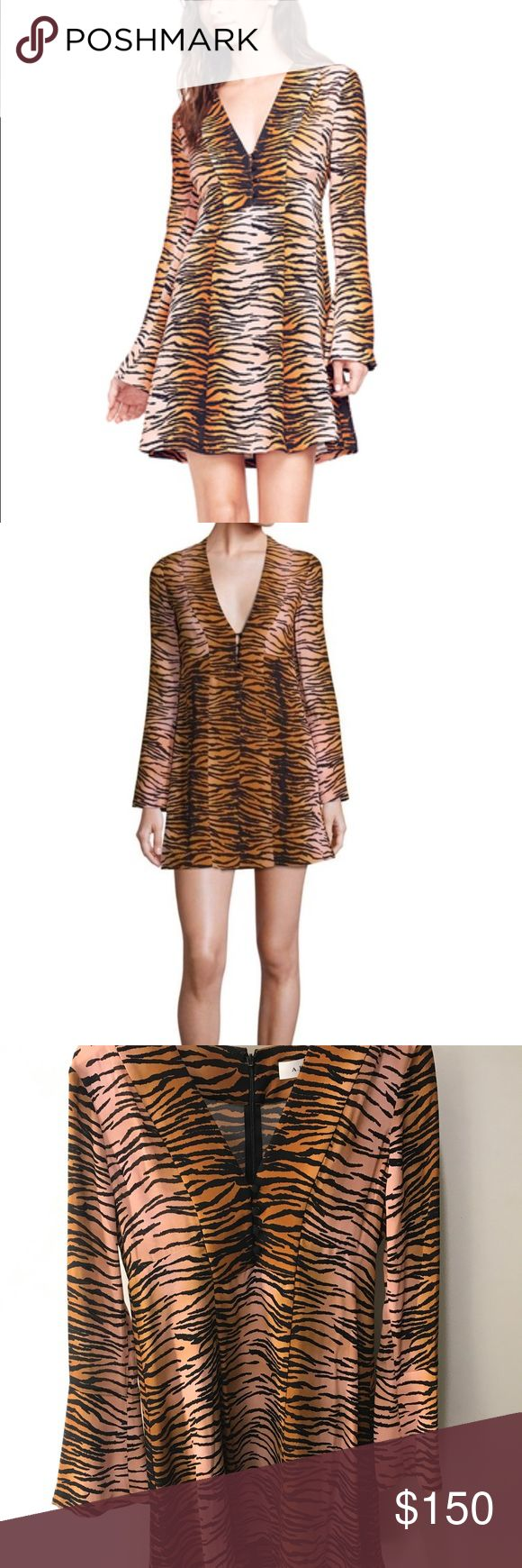 """ALC tiger print dress! Never been worn! Eye-catchy tiger printed dress exudes appeal. deep v-neckline. front button closure. long sleeves. concealed back zip closure. about 35"""" from shoulder to hem. silk. A.L.C. Dresses Mini"""