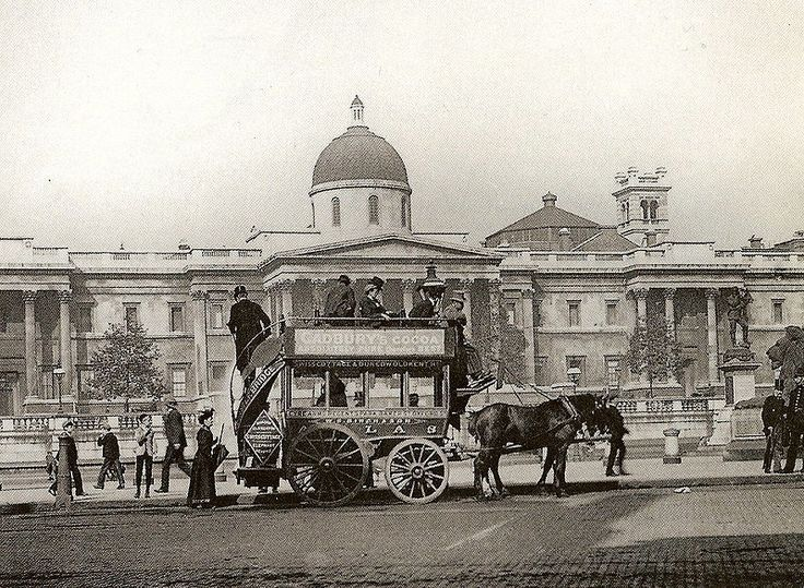 """A Horse drawn bus in Trafalgar Square in front of the National Gallery. The word """"Atlas"""" on the side of the bus is the name of the route it is assigned to. The Atlas route ran seven miles from Eyre Arms in St John's Wood to the Red Lion at Camberwell Gate this took just over an hour."""