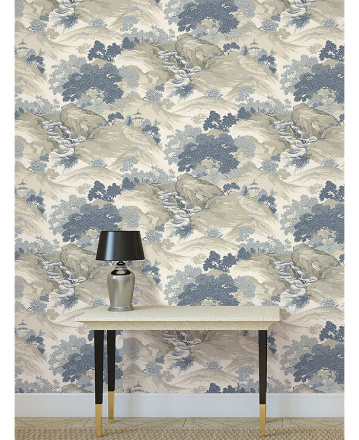 The Crown Archives Oriental Landscape Wallpaper in blue, grey and cream is a modern take on a classic wallpaper with subtle metallic highlights. Free UK delivery available