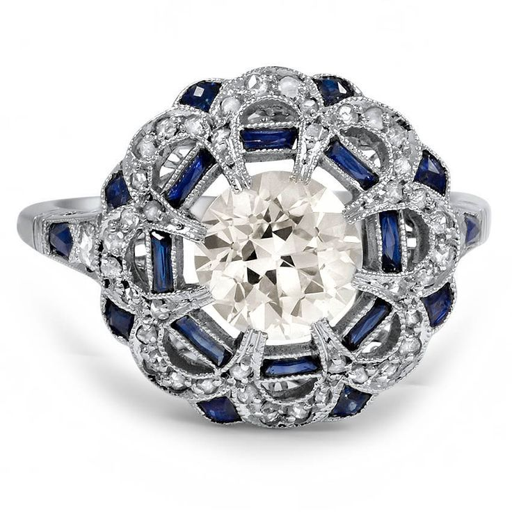 The Celandina Ring - Current price $13,940. Old European cut 1.53 ct diamond sits in platinum ring from the 1920's Art Deco. Also forty-trwo rose cut diamonds, 18 natural sapphire accents.