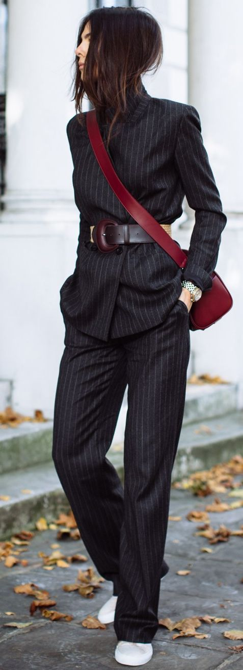 Pinstripe suit/wide belt/smart-casual.