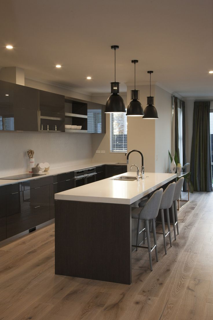 Engineered Timber Flooring Runs Throughout The Open Plan Living And Kitchen.  Acrylic Glass Kitchen Cabinets
