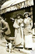 Coco Chanel walking her Cavalier King Charles Spaniels in 1913