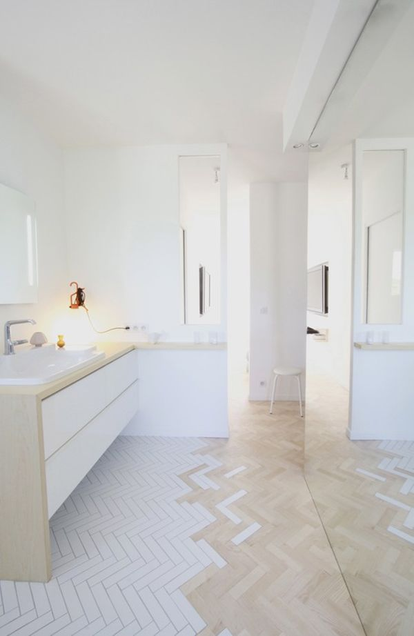 or use the same rectangular tiles that are on wall, in chevron patter on floor