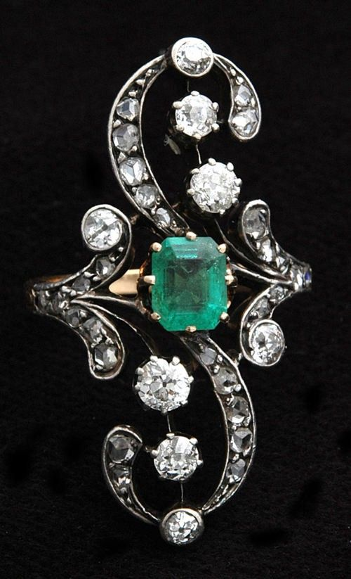 """""""Dress Ring"""" from Russia with Love (circa.1890) step-cut emerald in 18k yellow gold, with surrounding old """"swiss cut"""" diamonds set in white gold"""