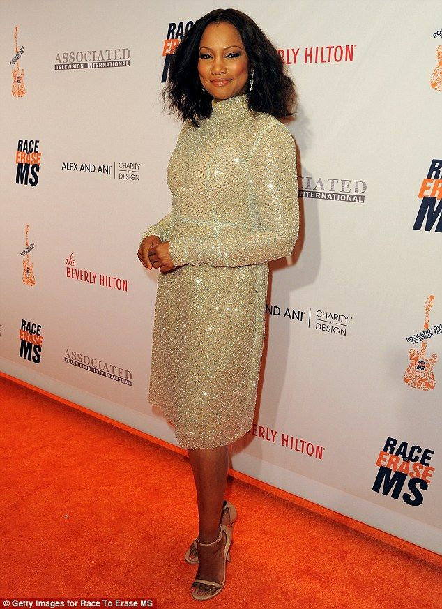 Dazzling: Garcelle Beauvais chose a golden knee-length dress with a shimmering pattern and...