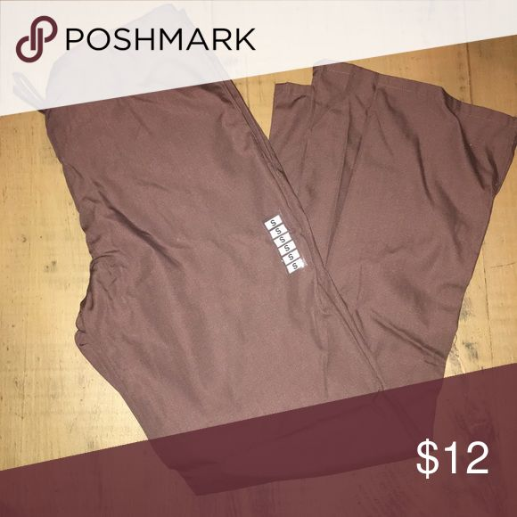 Brand-new Cherokee drawstring scrub pants! Brand-new still has a tag on it, they were miss marked when I purchased them. They are smalls, not small tall as I was told. Tried them on and realized it very quickly! Cherokee Pants