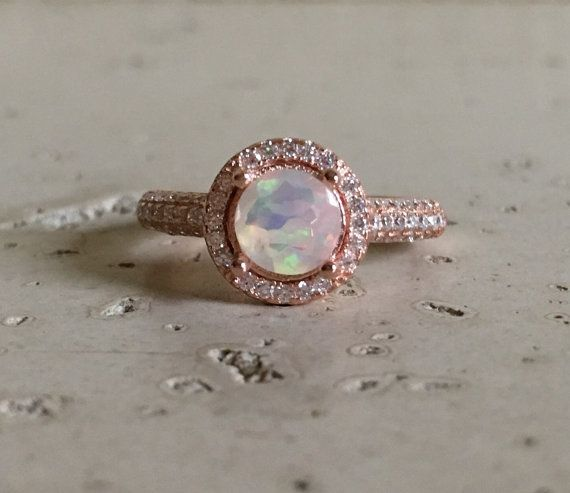 Hey, I found this really awesome Etsy listing at https://www.etsy.com/listing/274693834/ethiopian-opal-engagement-ring-halo-ring