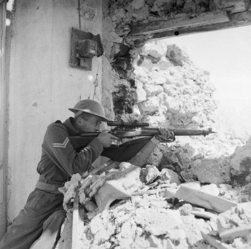A New Zealand sniper positions himself amongst the ruins and takes aim with his rifle during the Battle of Monte Cassino. The Battle of Monte Cassino was a costly series of four assaults by the Allies against the Winter Line in Italy held by the Germans and Italians during the Italian Campaign. The intention was a breakthrough to Rome. Cassino, Frosinone, Lazio, Italy. 26 March 1944.
